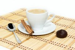 Cup of espresso coffee. Cup of espresso, cinnamon and candy royalty free stock photos