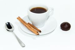 Cup of espresso coffee. Cup of espresso, cinnamon and candy royalty free stock image