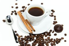 Cup of espresso coffee. Cup of espresso, cinnamon and candy. Coffee beans around the cup royalty free stock images