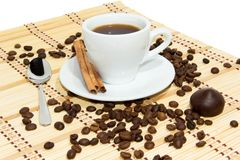Cup of espresso coffee. Cup of espresso, cinnamon and candy. Coffee beans around the cup stock photos