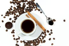 Cup of espresso coffee. Cup of espresso, cinnamon and candy. Coffee beans around the cup stock photo