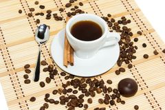 Cup of espresso coffee. Cup of espresso, cinnamon and candy. Coffee beans around the cup stock images