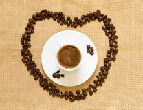 Cup of espresso coffee and coffee beans Royalty Free Stock Photography