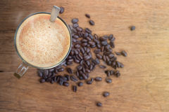 Cup of Espresso coffee and coffee beans on wooden background. Stock Photo