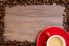Cup of espresso coffee with frame of beans Stock Image