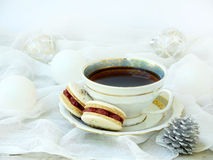 Cup of espresso coffee, French macaroons dessert Christmas and New Year cookies. Cup of espresso coffee, French macaroons dessert on light background. Christmas Stock Images
