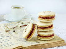 Cup of espresso coffee and French macaroons dessert. On light background Royalty Free Stock Photo