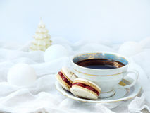Cup of espresso coffee, French macaroons dessert on light background. Christmas and New Year cookies Stock Photo