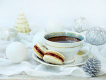 Cup of espresso coffee, French macaroons dessert on light background. Christmas and New Year cookies Royalty Free Stock Photos