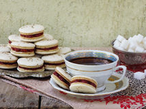 Cup of espresso coffee and French macaroons dessert. On wooden background Royalty Free Stock Images