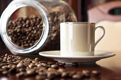 Cup of espresso. And coffee grains. Coffee background Royalty Free Stock Photos