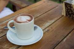 A cup of espresso coffee with heart-shape foam on top Royalty Free Stock Photo