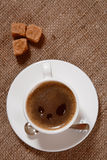 Cup of Espresso coffee on hessian background Royalty Free Stock Photos
