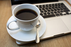 Cup of espresso coffee. Cup of espresso  coffee on laptop Stock Image