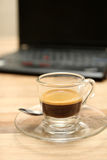 Cup of  espresso coffee with laptop Stock Photography