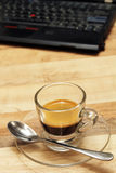 Cup of  espresso coffee with laptop - Series 2 Royalty Free Stock Image