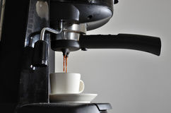 Cup of espresso and coffee machine Royalty Free Stock Photo