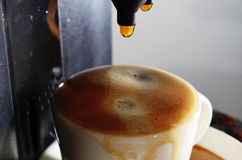 Cup of espresso and coffee machine Royalty Free Stock Photography