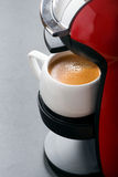 Cup of espresso in the coffee machine, vertical Stock Photo