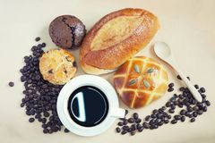 Cup of espresso coffee and many fresh baked breads on white shab Royalty Free Stock Photography