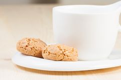 Cup of espresso coffee near biscuit Royalty Free Stock Photos