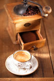 A cup of espresso coffee with Old coffee mill  textured table Stock Photo