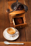 A cup of espresso coffee with Old coffee mill  textured table Royalty Free Stock Photos