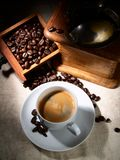 Cup of espresso coffee, old grinder and beans Stock Images