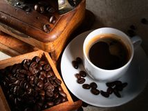 Cup of espresso coffee, old grinder and beans Stock Photo