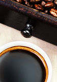 Cup of espresso  coffee with roasted coffee beans macro. Black c Royalty Free Stock Image