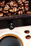 Cup of espresso  coffee with roasted coffee beans macro. Black c Royalty Free Stock Photos