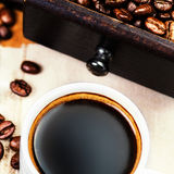Cup of espresso  coffee with roasted coffee beans Stock Photos