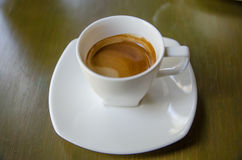 Cup of espresso coffee. On the table Royalty Free Stock Image