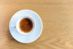 Cup of espresso coffee on the wooden table Stock Photo
