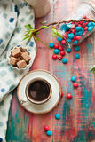 Cup of espresso with colorful sweets on wooden table Stock Image