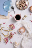 Cup of espresso and cupcake and beautiful tulip flowers over white background. Top view. Royalty Free Stock Images