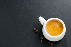 Cup of espresso on a dark background and space for your text Royalty Free Stock Image