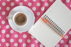 Cup of espresso with diary on vintage Stock Photography