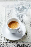 Cup of espresso and a glass of water Stock Photo