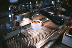 Cup of espresso on machine Stock Photography
