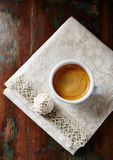 Cup of espresso with meringue cookie Royalty Free Stock Image