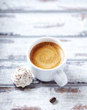 Cup of espresso with a meringue cookie Stock Image