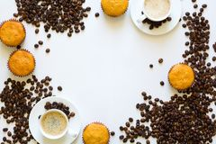 Cup of espresso with muffins and coffee beans on white table Royalty Free Stock Image