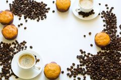 Cup of espresso with muffins and coffee beans on white table Stock Photos