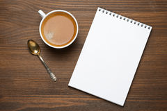 Cup of espresso and note pad, concept photo, top view Stock Photography
