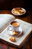 Cup of espresso on a open book Royalty Free Stock Photo