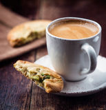 Cup of espresso and pistachio cookie Stock Photos
