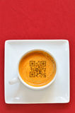 Cup of espresso and smartphones code Stock Photo