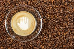 Cup of espresso with stop gesture sign on coffee foam on coffee beans background. With copy space stock photography