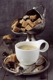 Cup of espresso, sugar cubes and chocolate candy on rustic wooden background Royalty Free Stock Photos